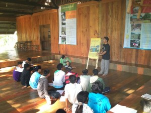 Local youth hold on-site workshops on assisted natural regeneration and water and forest management. P Walpole