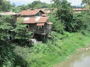 Houses are allowed, and continue, to be built dangerously, this one on a riverbank, putting its residents at high risk. Photo credits: ESSC