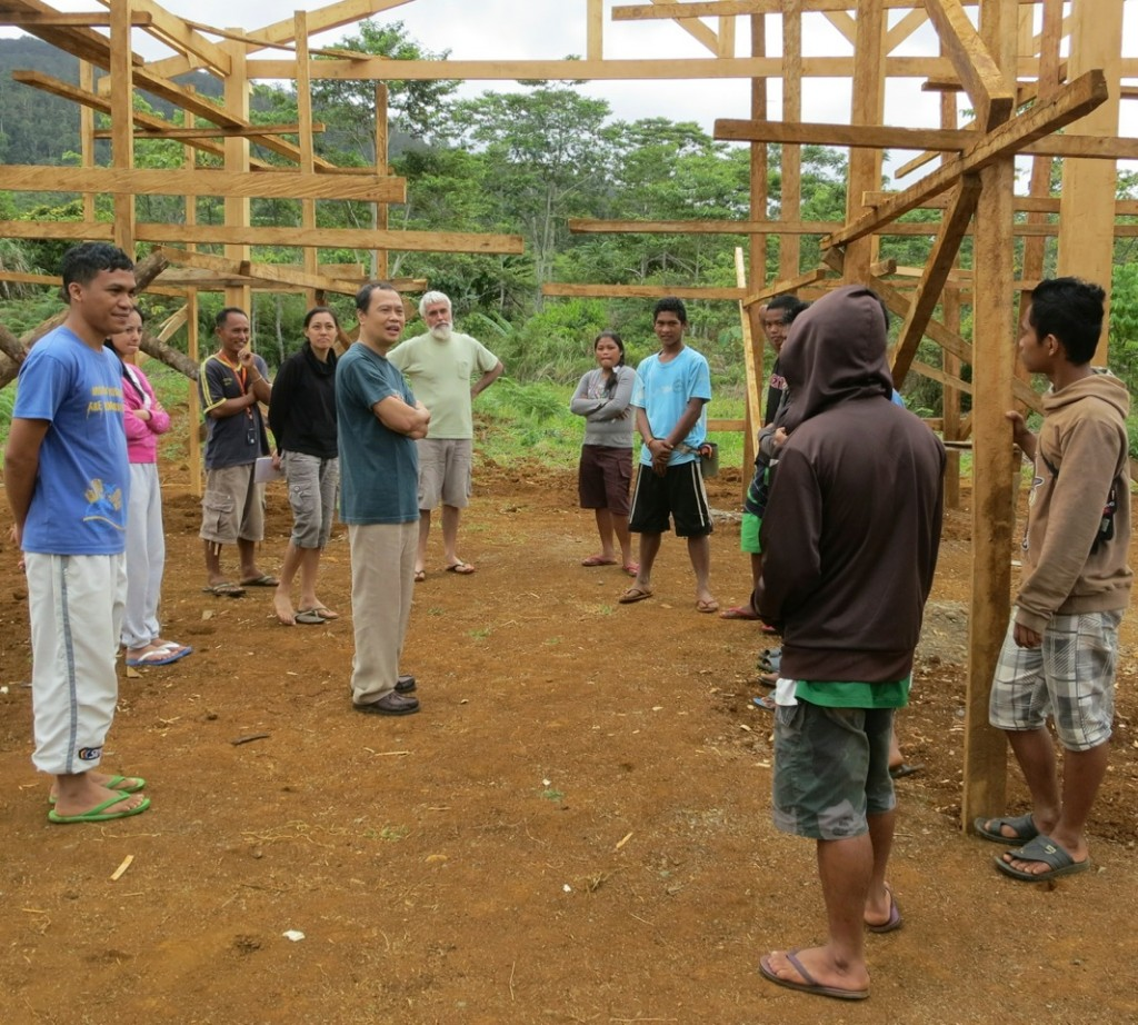 Fr Tony visiting upland indigenous youth doing carpentry construction in Bukidnon, Philippines as part of a broader integral ecology program for young adults, with skills training and values formation. Photo credit: ESSC