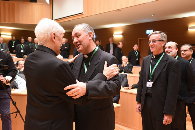Greeting Father Arturo Sosa, the 31st Superior General of the Society of Jesus. Photo credit: gc36.org