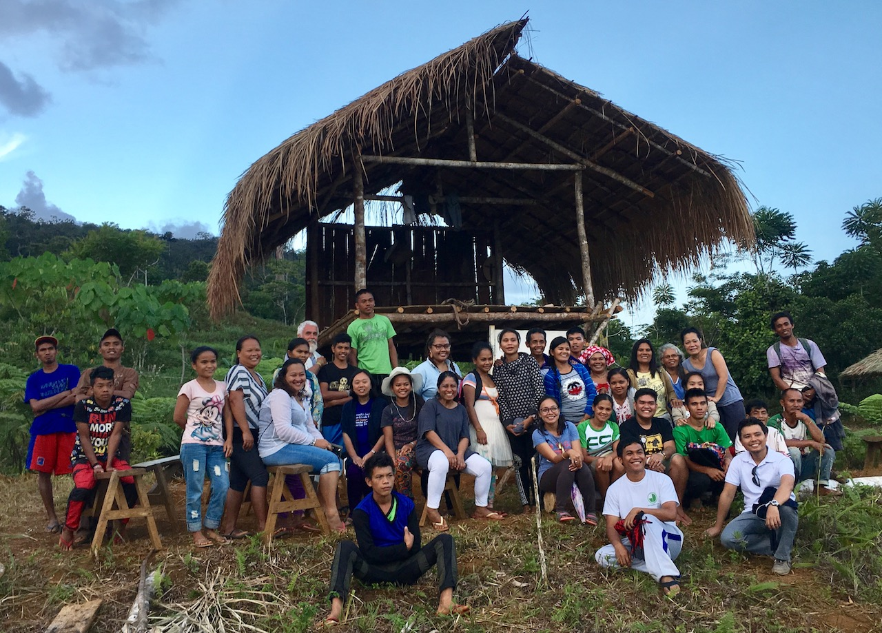 ESSC staff of community foresters, young Jesuit volunteers, eco-agriculture farmers, youth training participants, and community school teachers gather on the slopes of the Pantaron, sharing a common vision and hope with an upland community in Bukidnon, Philippines in a changing land and a changing climate. Photo credit: S Miclat, ESSC