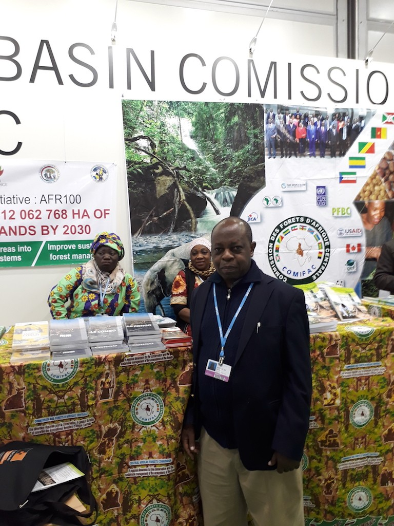 Rigobert at the COMIFAC exhibit booth in COP23
