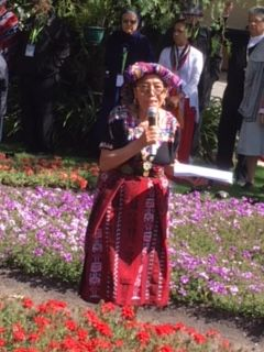 An indigenous woman leading the Madre Tierra celebration