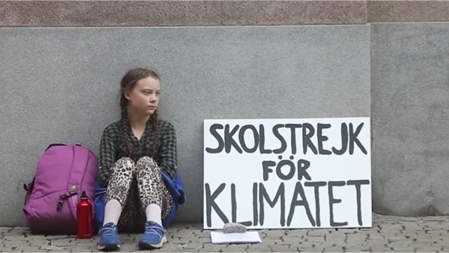 Greta Thunberg outside the Swedish Parliament when she began her protest against her government's inaction on climate change