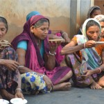 Tea-drinking in Zadoli village in the Nadami district of Gujarat state with the Adivasi community whose traditional home is in the forests of the central plains of India. (Photo credit: R Javier)