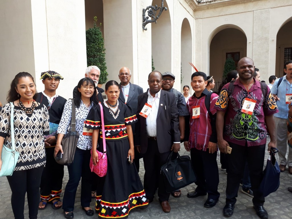 Fr Rigobert Minani (front row, fourth from left) joins the Asia Pacific group from various indigenous communities during the 3rd Anniversary of Laudato Si' at the Vatican in July 2018.