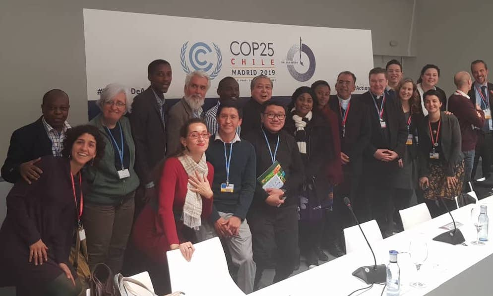 : Fr Rigobert Minani (leftmost), REBAC Coordinator, with other participants during COP25 in Madrid, Spain